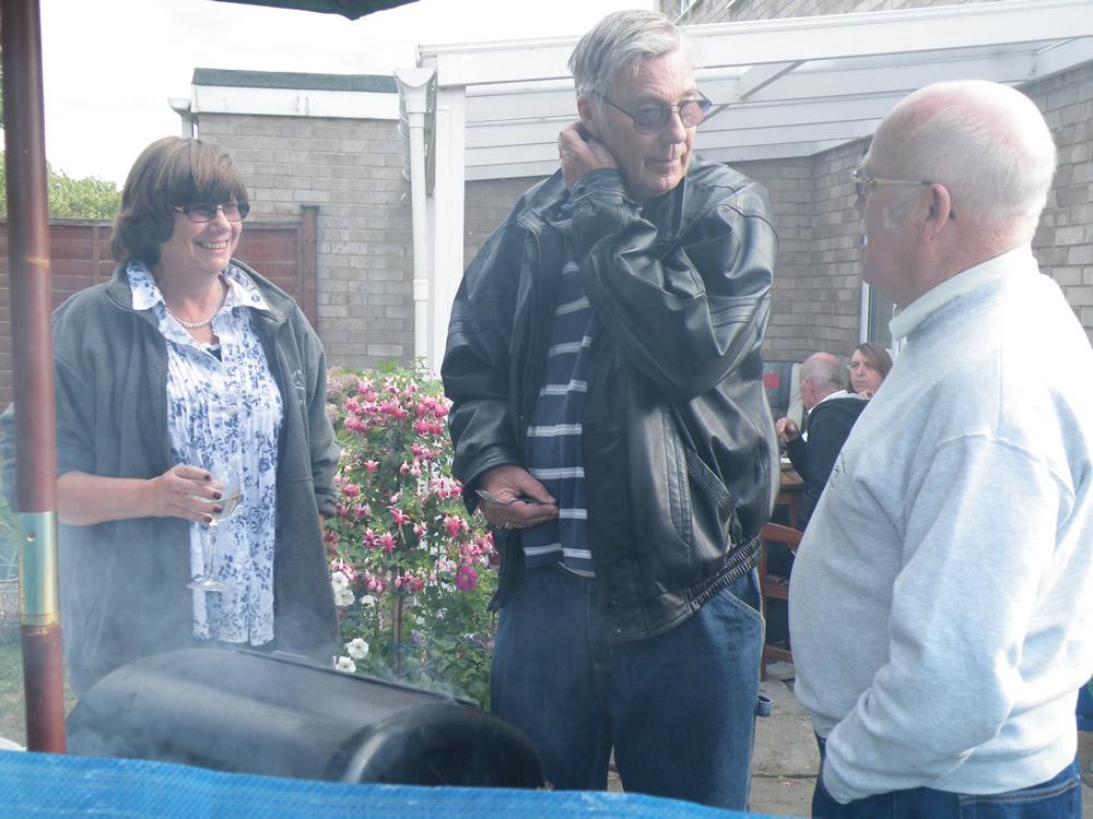 Linda, Chris & Tony round the smoky BBQ