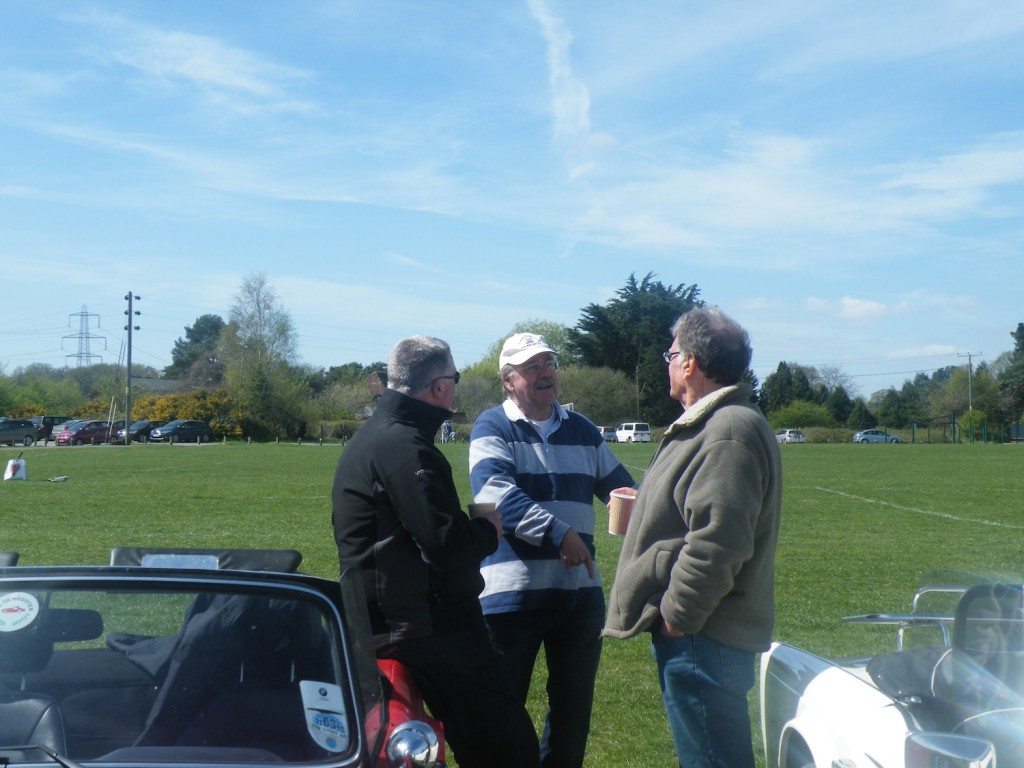 Roger explaining to Steve and Andy that they are standing on grass not a road