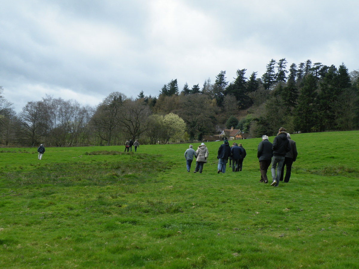 Wandering back down the Hill. Christophe regrets walking through the cow pats